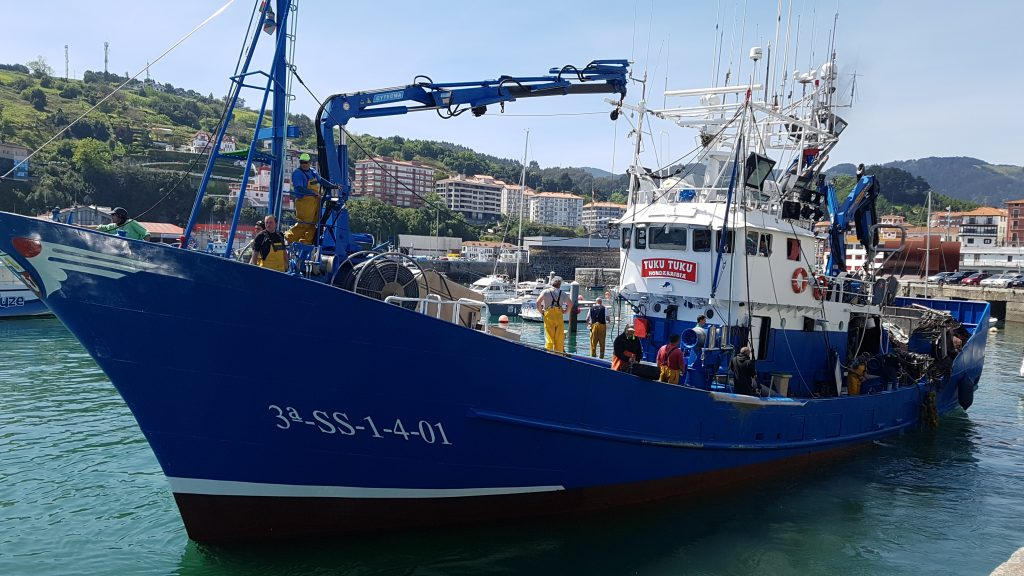 Traditional blue Basque fishing boat at the port of Bermeo, Basque Country